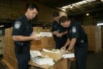 U.S. CBP officers inspecting items. Image source: Photo by James R. Tourtellotte, from CBP's multimedia gallery.