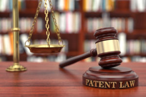 """gavel and scales with word """"patent"""""""
